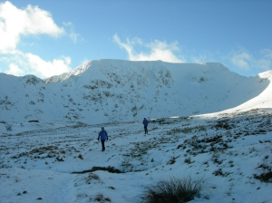 Walking up towards Red Tarn Helvellyn face and gullys in the background