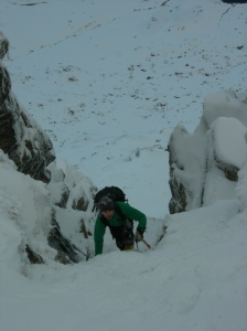 A following climber starting the final section above the main groove of No1 gully