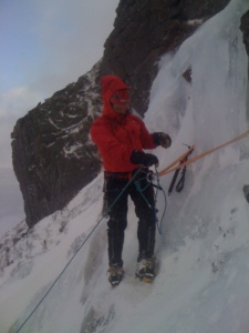 Setting up the belay on the second pitch of ice