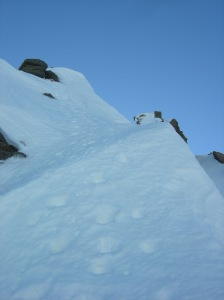"Nearing the top of ""Fluted Buttress Direct"" the hard part over, just follow the crumbling footprints"